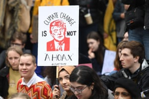Supporters carry placards as they march during the YouthStrike4Climate demonstration in central London