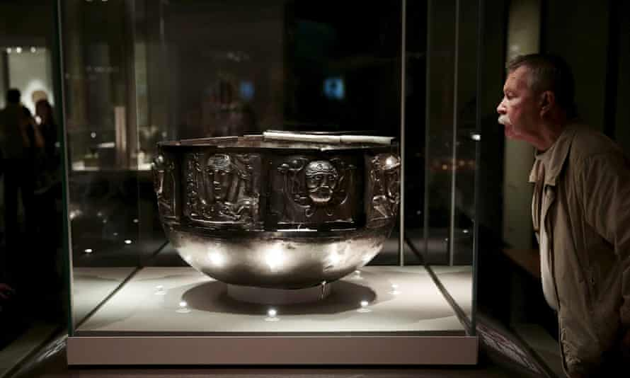 A visitor looks at the Gundestrup cauldron displayed in the 'Celts: art and identity' exhibition at the British Museum.
