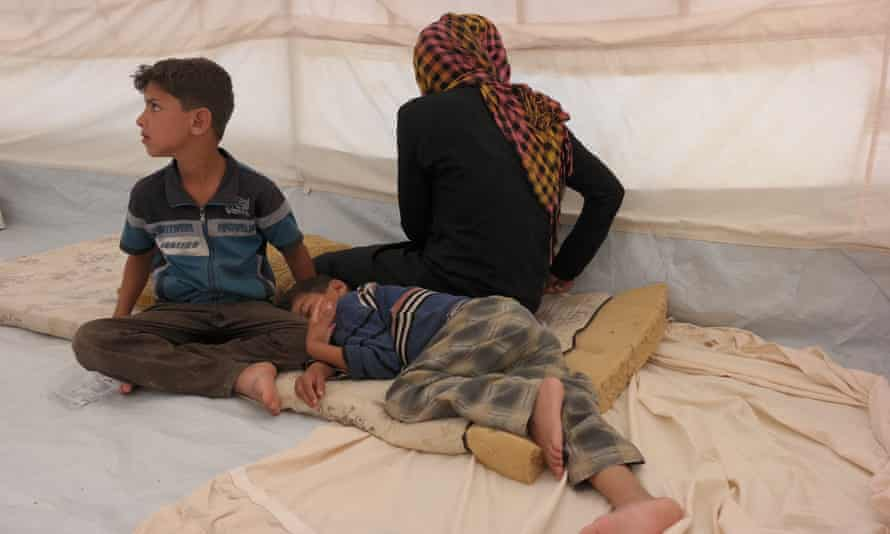 """Mohammed (sitting up) told us: """"My feet were very painful and tired after having to run all night"""""""