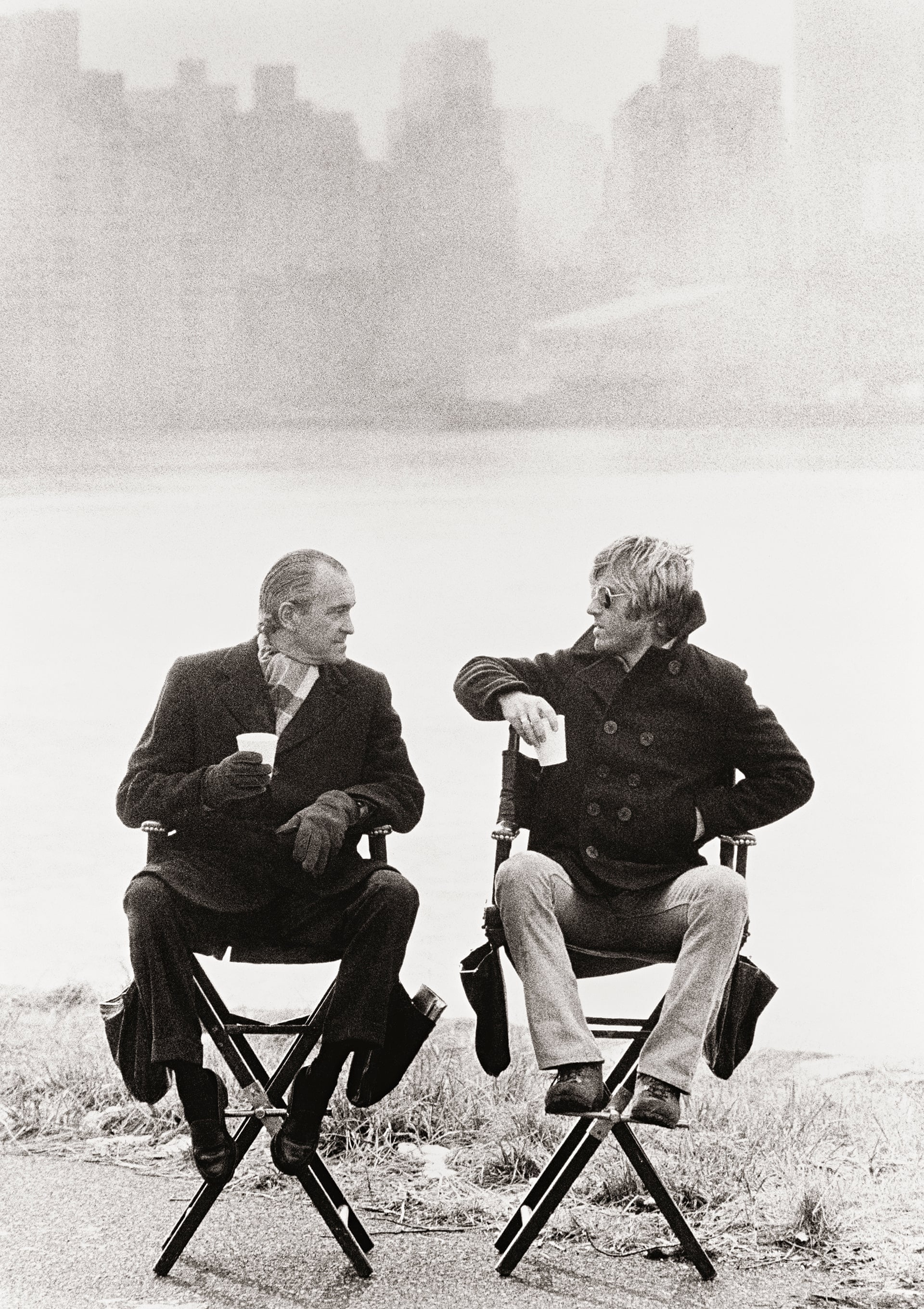 An image of Robert Redford in conversation with Richard Helms, a former CIA director