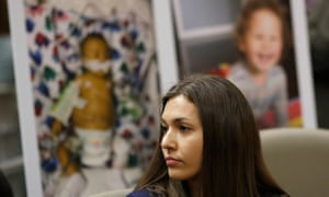 Alyssa Hernandez's son Noah, seen in photos in the background, received a liver transplant when he was six months old and cannot be vaccinated against many vaccine-preventable diseases.