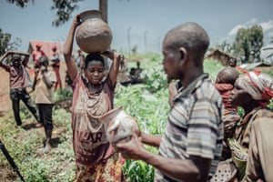 Pygmies sell handmade pottery to tourists and community members