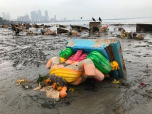The aftermath of idol immersion on Mahim beach, Mumbai, in 2018.