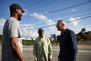 Devon Holloway and Tone Lane of the Pittsburgh Homeowners Association speak with a business owner across from the new Pittsburgh Yard development.