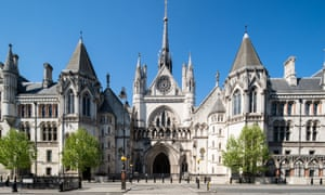 A view of The Royal Courts of Justice in London as the UK continues in lockdown .