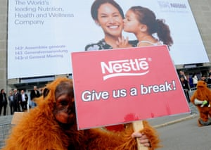 Greenpeace protestors dressed as orangutans demonstrate against palm oil harvested from rainforest destruction outside a Nestle shareholders' meeting