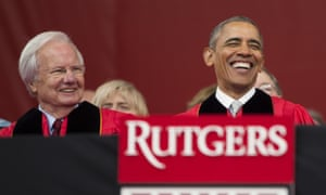 Obama, right, laughs as he sits with Bill Moyers during the ceremony.