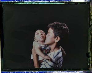 Elisson Campos with his one-year-old brother, José Wesley Campos. Elisson is very close to his baby brother and loves to hold him in his arms.