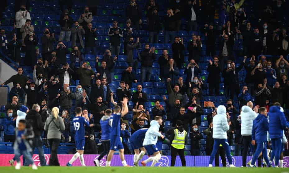 Chelsea fans applaud their team after a Premier League match against Leicester City at Stamford Bridge in May. 2021