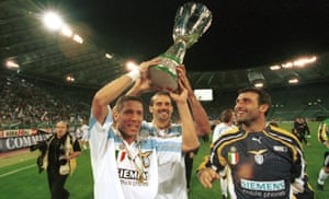 Diego Simeone, Giuseppe Pancaro and Angelo Peruzzi celebrate after winning the Italian Supercup in 2000.