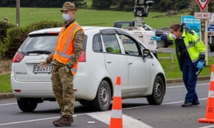 Police and military personnel set up a coronavirus checkpoint in Auckland, New Zealand. Defence force personnel are bolstering the country's quarantine system.
