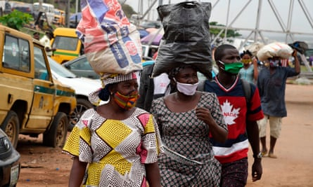 People wears face masks in compliance with state rules in Ojodu-Berger, Lagos, Nigeria.