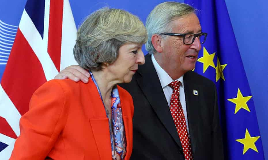 Theresa May is welcomed by European commission president Jean-Claude Juncker in Brussels