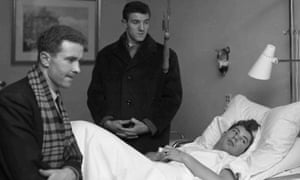 Harry Gregg, left, and Billy Foulkes, visiting their injured Manchester United team mate Ken Morgan in February 1958, shortly after a plane carrying the team crashed at Munich airport.