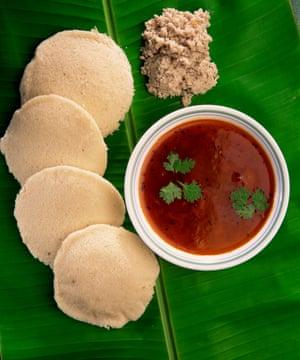 Sambar with idli (lentil cake) and coconut chutney on a banana leaf.