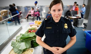 Tasha Mashburn near some agricultural contraband confiscated from the luggage of international travelers arriving at the airport.