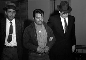 Perry Smith is led by police officers into the courthouse in 1960.