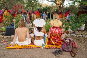 Attendees of Woodford folk festival 2019-20 sit by the labyrinth.