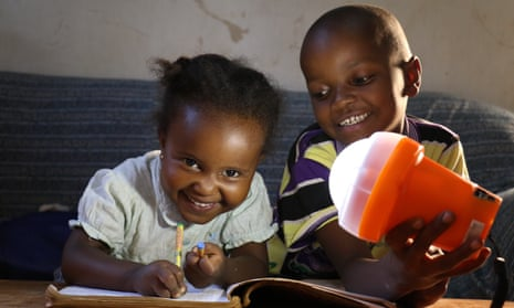 Two children with off-grid solar light