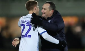 Tranmere Rovers manager Micky Mellon celebrates with Harvey Gilmour after the second-round replay win over Southport