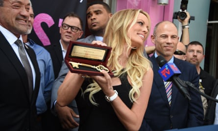 Stormy Daniels receives her key to the city of West Hollywood from Mayor John Duran, left, as Avenatti looks on.