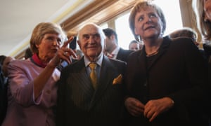 Friede Springer, left, Lord Weidenfeld and the German chancellor Angela Merkel attending the annual new year reception at the publishing group Axel Springer in Berlin in 2008.