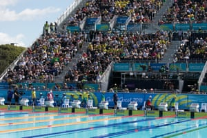 Athletes walk on to the pool deck for a men's S7 50m freestyle heat