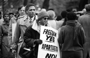 Rosa Parks demonstrates against apartheid at the South African Embassy in Washington in 1984.