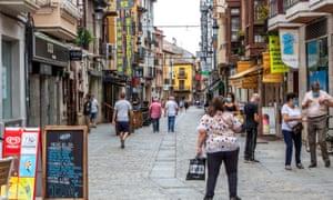 People walk in central Aranda del Duero, northern Spain
