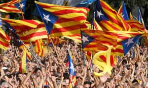 People wave separatist flags at a rally in Barcelona