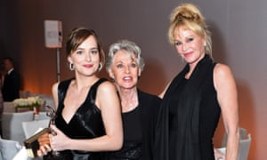 Dakota Johnson, Tippi Hedren and Melanie Griffith pose with the Calvin Klein Emerging Star Award at ELLE Women in Hollywood Awards.