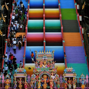 Visitors walk up the newly-painted 272-steps staircase leading to Malaysia's Batu Caves Hindu temple in Kuala Lumpur