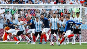 France's Antoine Griezmann shoots from a free kick.