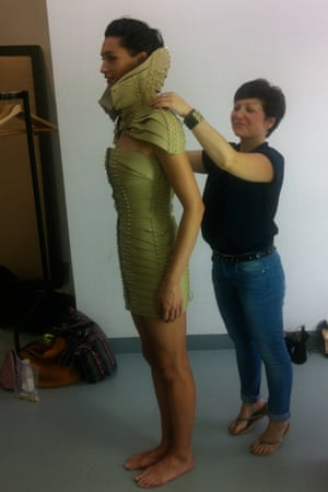 Model being fitted with leather dress created by Úna Burke
