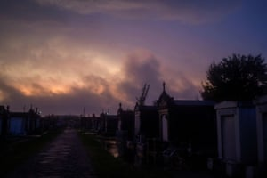 Clouds move over a cemetery as the remnants of Hurricane Zeta sweep through New Orleans.
