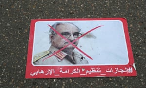 A poster of Khalifa Haftar is seen on the ground in Tripoli, Libya
