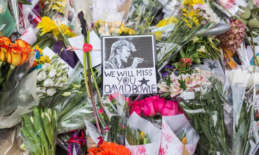 Flowers at a makeshift memorial outside the apartment building where David Bowie lived in New York.