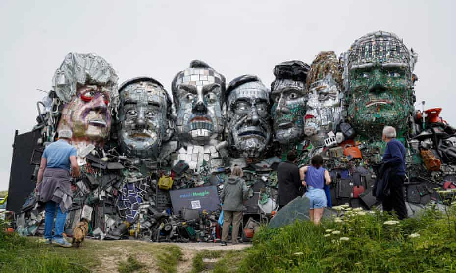 Mount Recyclemore, a giant sculpture of Boris Johnson, Joe Biden and fellow G7 leaders on a clifftop near Carbis Bay, Cornwall.
