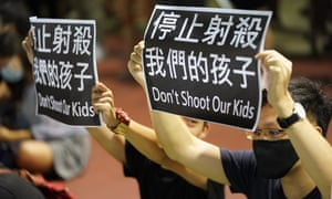 A protest against a teenage demonstrator being shot at close range in the chest by a police officer in Hong Kong on 1 October.