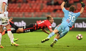 Lachlan Scott misses a header in front of goal as goalkeeper Daniel Margush dives for the ball during the match between the Western Sydney Wanderers and Adelaide United at Spotless Stadium on Saturday.
