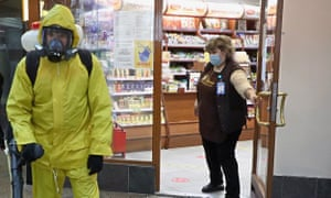 A Russian Emergency Situations Ministry worker sanitises Belorussky railway station.