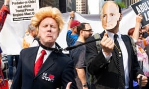A fake Donald Trump on a leash held by a fake Vladimir Putin at a protest rally against Donald Trump in New York in May 2018