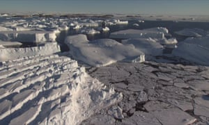 Large ocean waves battering the Antarctic ice shelf