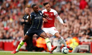 Raheem Sterling and Arsenal's Mesut Özil battle for possession in Manchester City's victory at the Emirates Stadium.