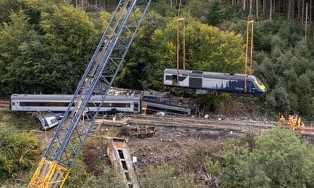 The engines is lifted by crane from the site of the Stonehaven rail crash after the fatal derailment of the ScotRail train.