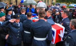Members of the public gather as the coffin of former RAF serviceman Oswald Dixon, 100, arrives at Agecroft Crematorium, Swinton, for his funeral.