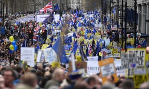 People carrying EU flags and banners march in central London.