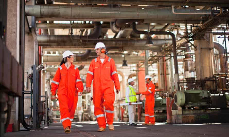 Workers walking at oil refineryGettyImages-149319767