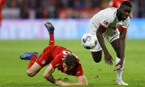 Bayern Munich's Thomas Müller (left) struggles to get past Dayot Upamecano, who was outstanding in defence for Leipzig