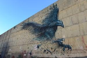 A all mural of a giant bird